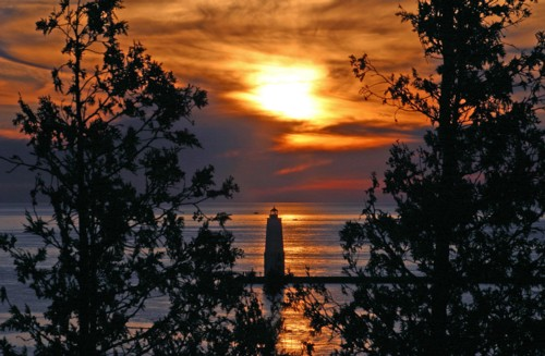 D-LH-149 - Sunset over Lake Michigan and the Harbor Lighthouse. Frankfort, MI.